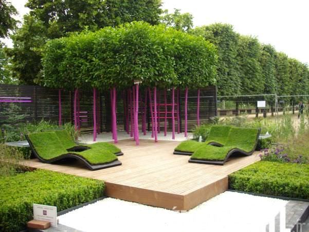 Lush artificial turf over outdoor lounge chairs.