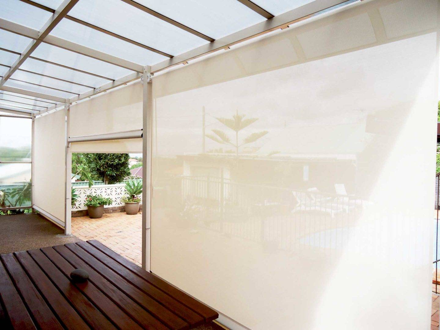 Opaque outdoor blinds could transform your backyard space.