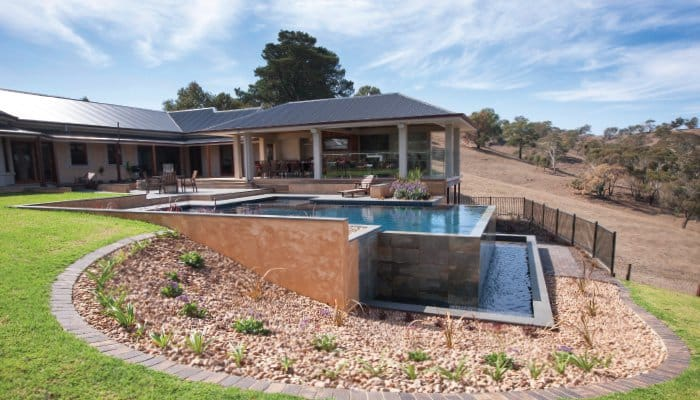 Swimming Pool Solutions For A Sloped Backyard - Concrete or Fibreglass Swimming Pool For A Sloped Backyard, Australian Outdoor Living.