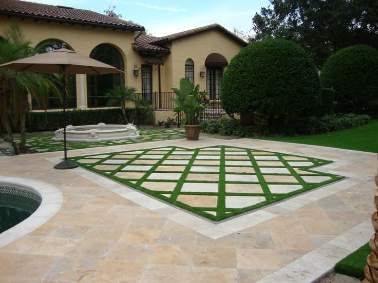 Unique Ways to Dress Up Your Concrete Floor with Artificial Grass - Another example of artificial grass being used in combination with traditional pavers, Australian Outdoor Living.