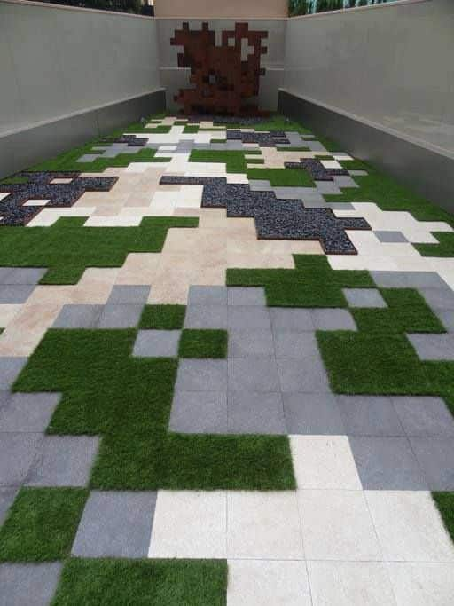 The geometric design of this outdoor patio is a fresh way to use artificial grass as pavers or tiles.