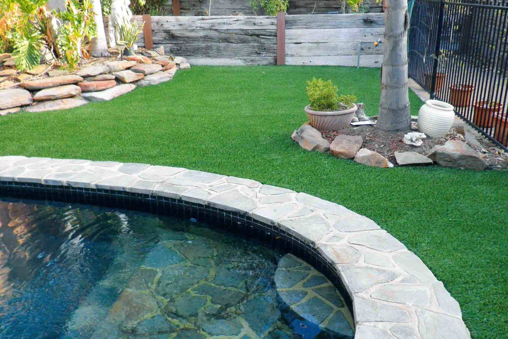 Artificial grass mixed with a fibreglass or concrete swimming pool is a winning combination.