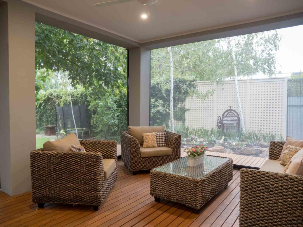 Outdoor furniture protected by outdoor blinds