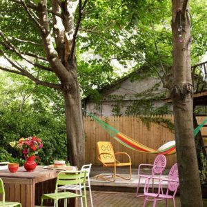 Colourful outdoor chairs in backyard