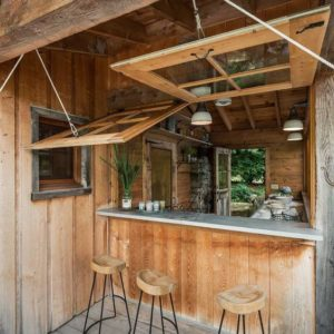 Hinged windows to connect kitchen with outdoors
